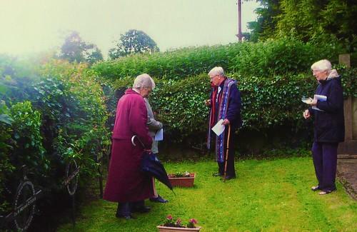 The graves of some of the Sisters are located on the Dún Lughaidh campus. In this picture, Fr Jim Pollack blesses their graves in the company of Sinead Beirne SSL (left) and Tríona McGinty SSL (right)
