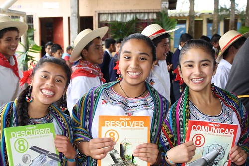 Indigenous girls with new textbooks