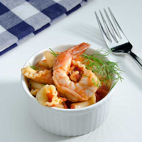 Pasta with Shrimp and Fennel in white ramekin with napkin and fork