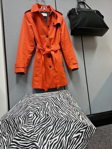 An orange cotton trench coat from Banana Republic
