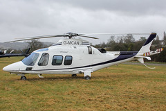 G-MCAN - 2006 build Agusta A109S Grand, at the 2013 Cheltenham Festival