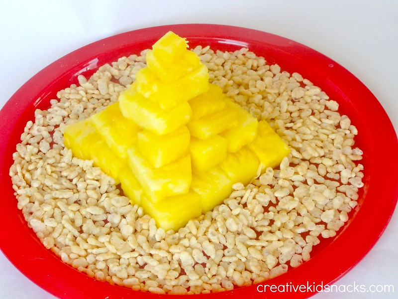 Teach the kids about the ancient pyramids using fresh pineapple chunks to build your own!