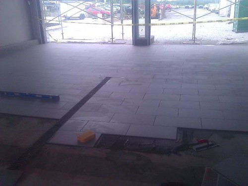Commercial porcelain anti-slipperty tile at car dealership
