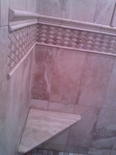 Porcelain and travertine tile