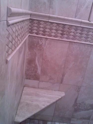 Porcelain and travertine tile