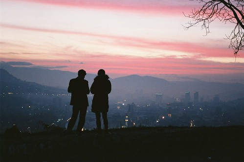 city pink sunset people panorama twilight haze view dusk sarajevo bosnia watching hills hazy bosna