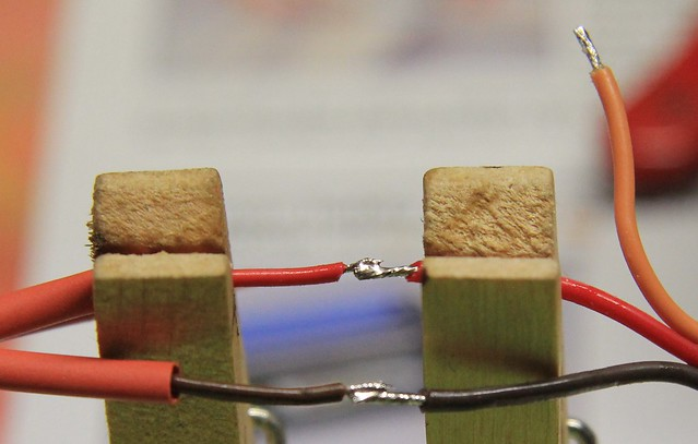Positive wire spliced