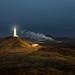 Lit Lighthouse by Oscar Bjarna