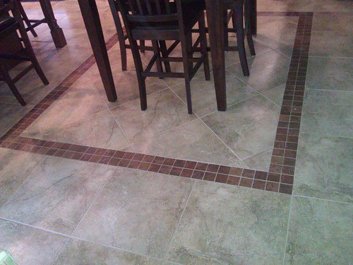 Porcelain tile with mosaic insert