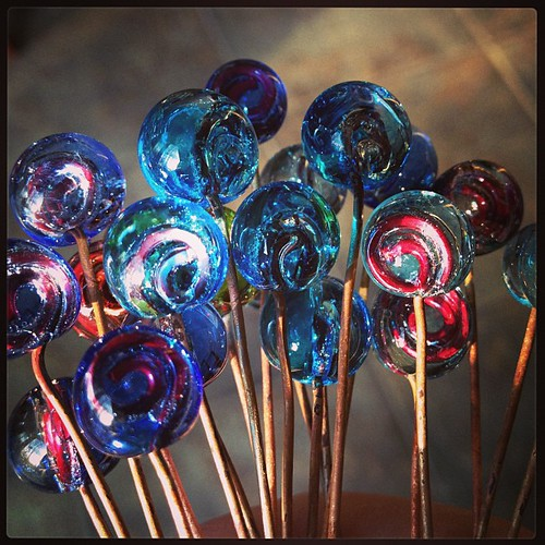 "New glass ""headpins"". Transparent encasing swirl of copper wire. #lampwork"