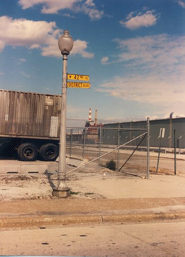Chicago's yellow street signs of the past in an industrial park.  Chicago Illinois.  October 1989. by Eddie from Chicago