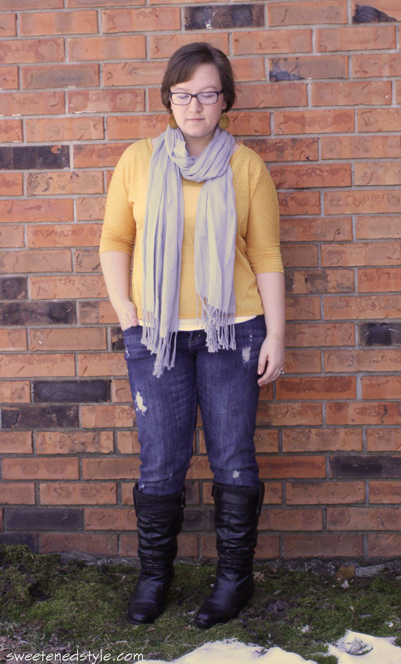 yellow top, grey scarf, ripped jeans, black boots