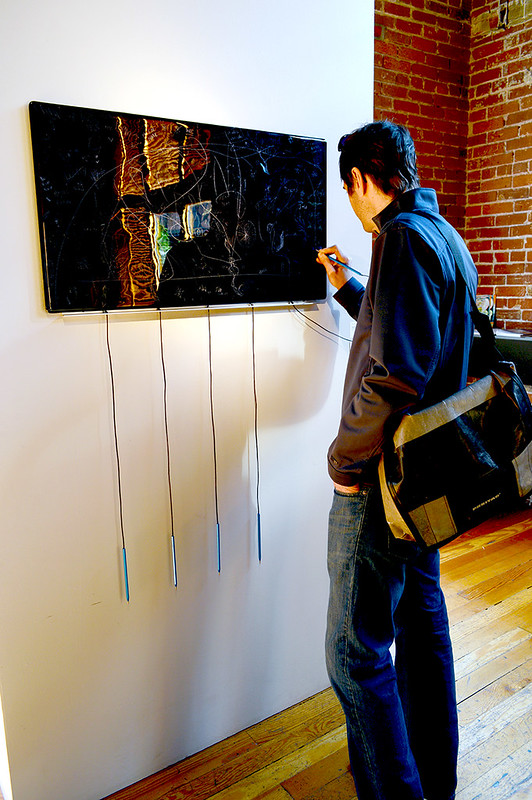 Scratching Glass Interactive Art