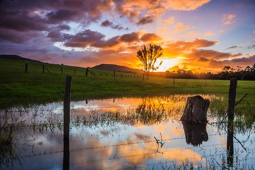 blue sunset orange reflection clouds rural fence reflections farm glastonbury australia stump barbedwire queensland gympie brooyar