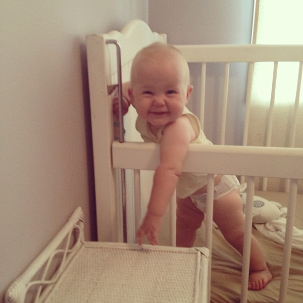 Good morning! This was how we were greeted this morning. :) (Think it's time to pull the side of the cot all the way up.) #cheekybaby