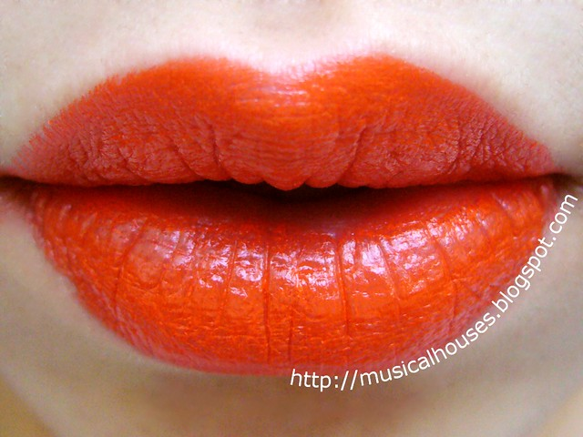 sleek tangerine scream lipstick