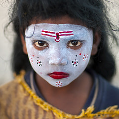 Little girl with make up in Kumbh Mela, Allahabad, India