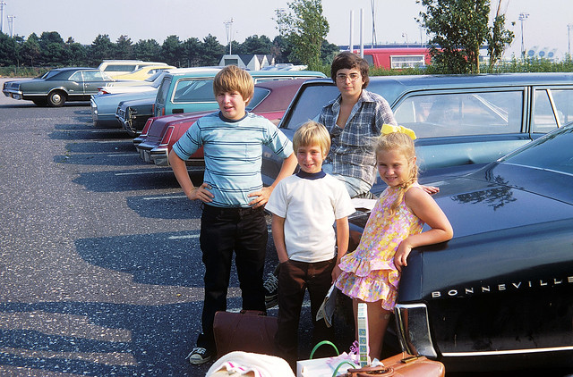 A somewhat nerdy 14 year old me on top of dad's 1965 Pontiac with our L.A. cousins who just arrived to spend the whole summer with us in Milford, Connecticut. JFK airport. Queens New York. July 1973.