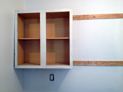 Diy installing kitchen cabinets for Attaching kitchen cabinets to wall