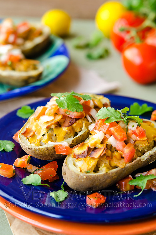 Spiced, Mexican Twice Baked Potatoes drizzled with queso sauce and topped with crispy coconut bacon and fresh pico de gallo. Vegan, Gluten-free