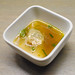 guinea hen dumpling with aromatic broth