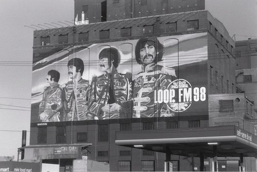 The W.L.U.P  FM  Radio billboard featuring a painted mural of The Beatles. (Gone -Demolished )  Chicago Illinois.  December 1989. by Eddie from Chicago