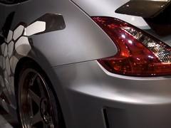 automobile(1.0), automotive exterior(1.0), wheel(1.0), vehicle(1.0), automotive design(1.0), nissan 370z(1.0), rim(1.0), bumper(1.0), land vehicle(1.0), luxury vehicle(1.0),