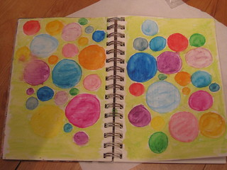 circles made from watercolor crayons and water