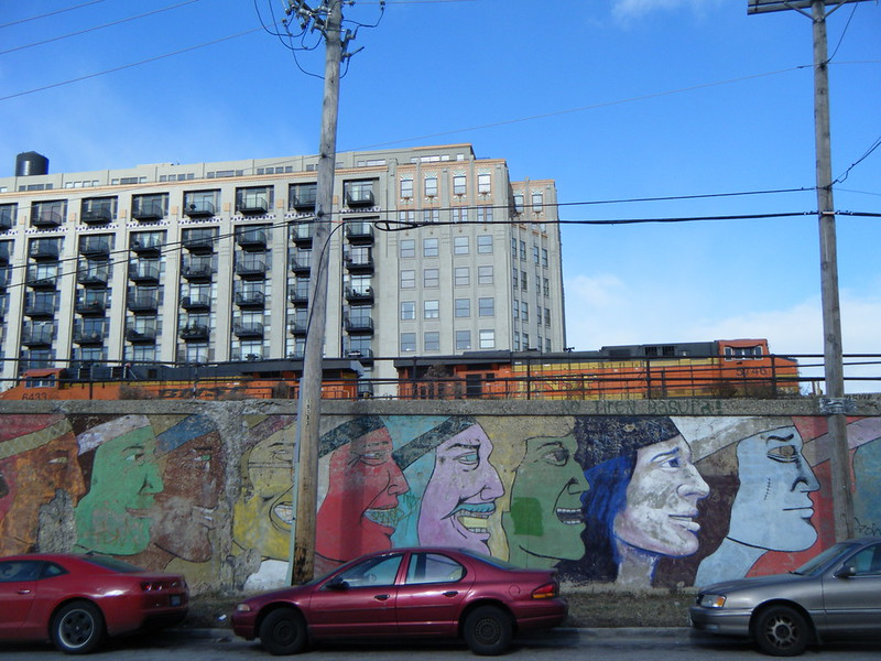 Produce Terminal Cold Storage building, BNSF engines, and faces in profile mural