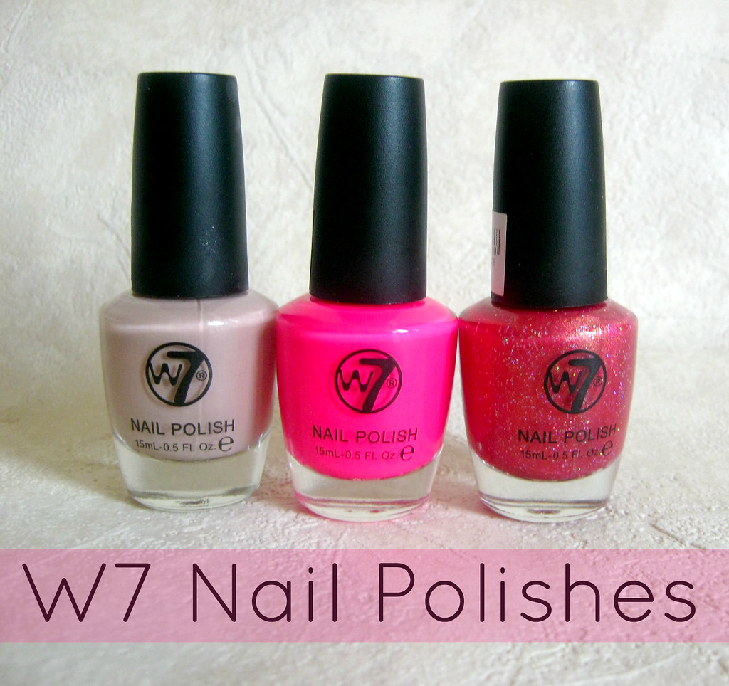 A picture of W7 nail polishes in Cafe Au lait, Space Debris and It's Pink.