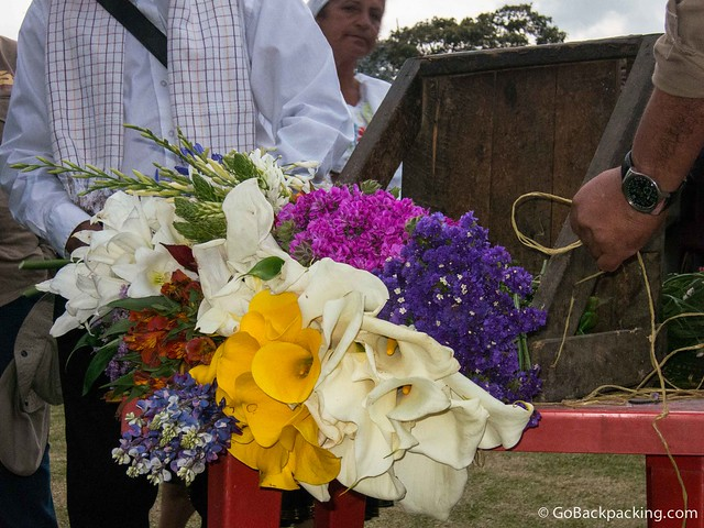 The silleteros demonstrate how they put together the silletas, or flower arrangements