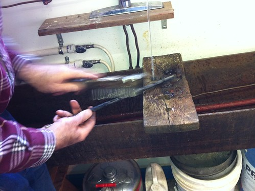 Cleaning the metal rod to re-cast a letterpress roller
