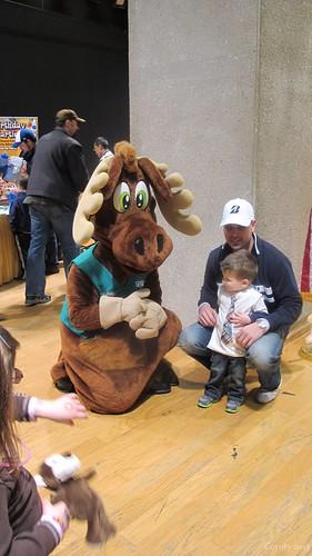 Spruce Moose mascot, kneeling by Coyoty