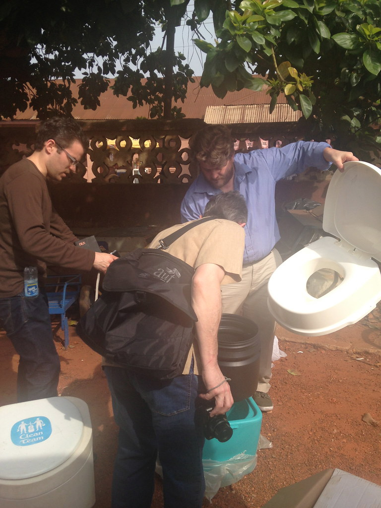 The Clean Team toilet is examined by the group