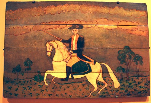 General George Washington riding a white horse, holding a sword, painted wood board, De Young Museum, San Francisco, California, USA by Wonderlane
