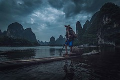 Paddling his raft