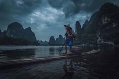 Paddling his raft