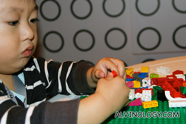 Asher playing with LEGO bricks