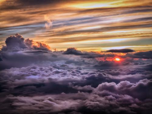 above sunset sky misty clouds ghostly