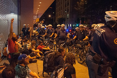 An occupier raises his fist in protest as Philadelphia PD bike unit kettles and arrests entire march during Occupy's National Gatherine