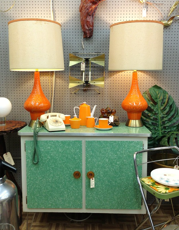 mid century kitchen cabinet and pair of orange lamps