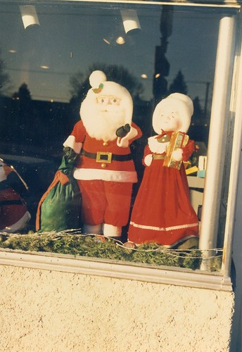 Mister and Mrs Santa Claus figures on display in a West 95th Street store wiindow.  Evergreen Park Illinois.  Early January 1988. by Eddie from Chicago