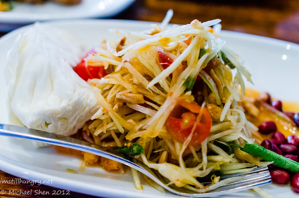 Spice I Am Som Tum (Green Papaya Salad) - Salad with sour & spicy taste, dried shrimp, peanuts and chilli.
