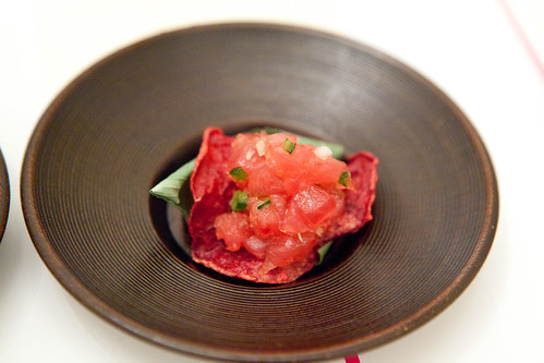 Raw tuna chopped - chili, olive oil on beet chip