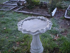 outdoor structure(0.0), garden(1.0), water feature(1.0), sculpture(1.0), yard(1.0), bird bath(1.0),