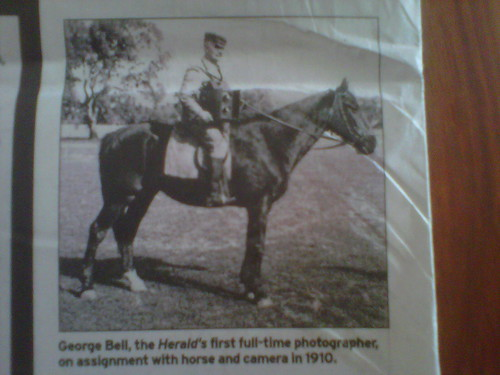 George Bell, the Herald's first full-time photographer, on assignment with horse and camera in 1910