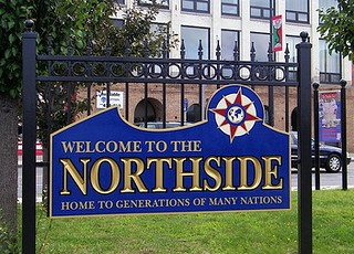"'Home to Generations of Many Nations"" (sign design by Stephanie Noble, photo courtesy of City of Syracuse)"