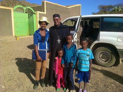 2013 - Mecce (Hayish, the building contractor's daughter) and Abune Tesfaselassie pose for a photo with three of the local children