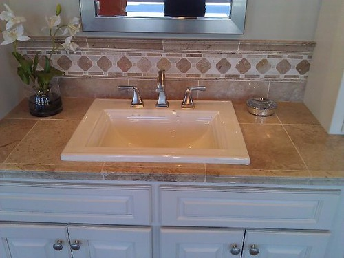 Travertine tile countertop and backsplash