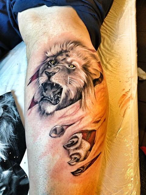 john lewis,lion,tattoo,colour,flesh,tear